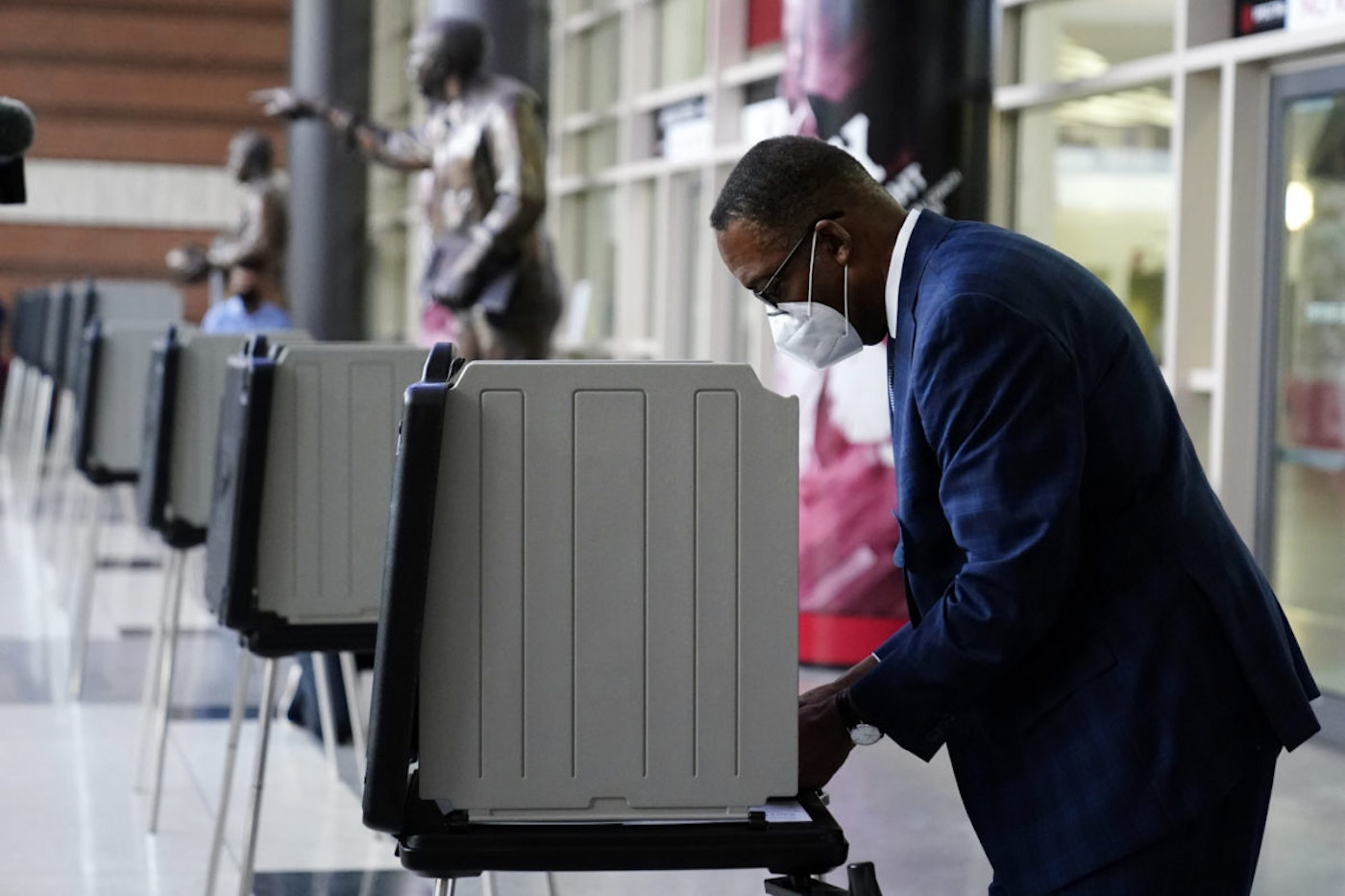 Philadelphia City Council President Darrell L. Clarke fills out his ballot at the opening of a satellite election office at Temple University's Liacouras Center, Tuesday, Sept. 29, 2020, in Philadelphia.   (AP Photo/Matt Slocum)