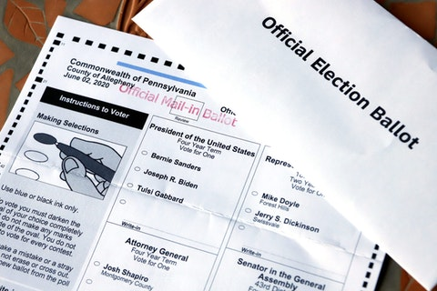 This May 26, 2020 file photo shows an Official Democratic General Primary mail-in ballot and secrecy envelope, for the Pennsylvania primary in Pittsburgh. (AP Photo/Gene J. Puskar/File)