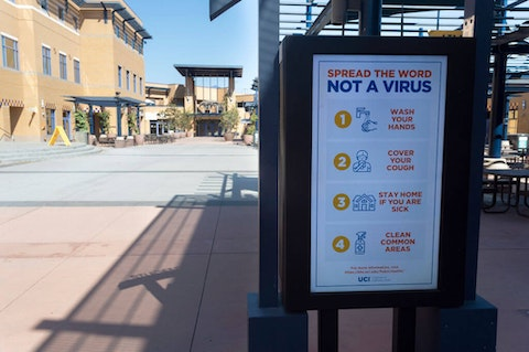 A sign describes safety precautions on a mostly empty campus at the University of California, Irvine in Irvine, CA on Friday, October 2, 2020. Classes started Thursday, October 1st but most are online, leaving few students on campus due to COVID-19 (coronavirus) restrictions. (Photo by Paul Bersebach/MediaNews Group/Orange County Register via Getty Images)