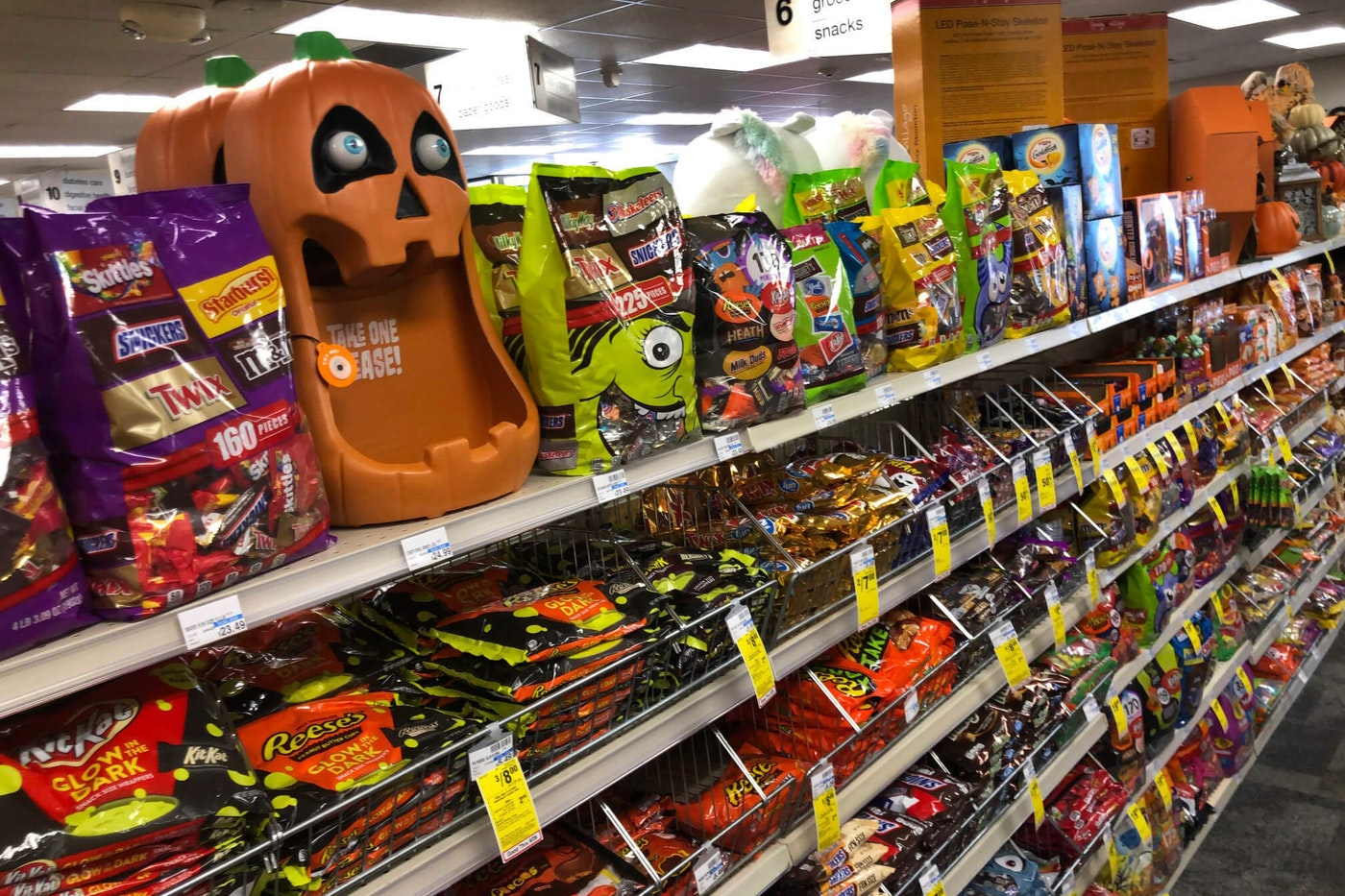 Halloween candy and decorations are displayed at a store, Wednesday, Sept. 23, 2020, in Freeport, Maine. In this year of the pandemic, with trick-or-treating still an uncertainty, US Halloween candy sales were up 13% over last year in the month ending Sept. 6, according to data from market research firm IRI and the National Confectioners Association. (AP Photo/Robert F. Bukaty)
