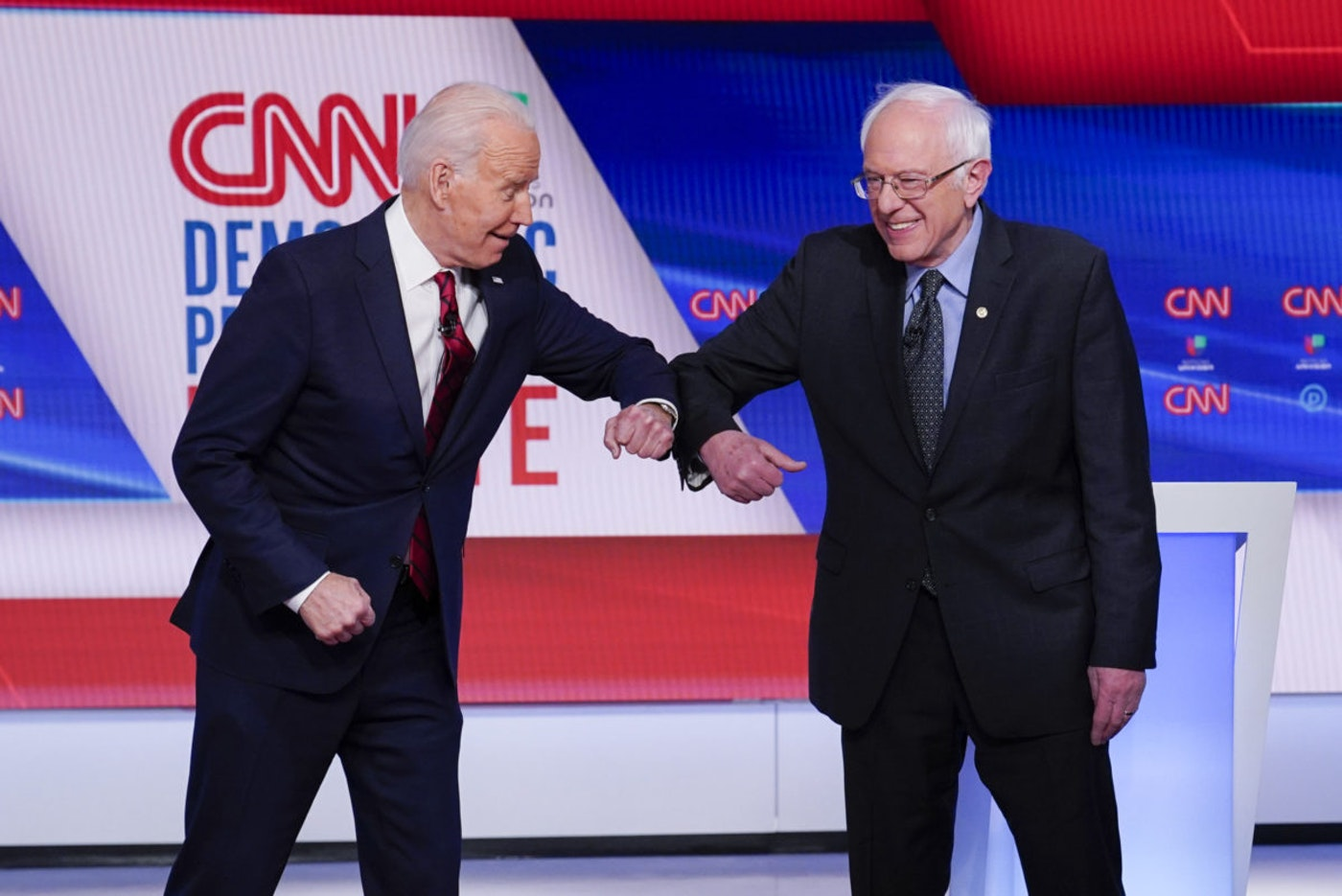 In this March 15, 2020 file photo, now Democratic presidential candidate former Vice President Joe Biden, left, and Sen. Bernie Sanders, D-Vt., right, greet one another before they participate in a Democratic presidential primary debate at CNN Studios in Washington. (AP Photo/Evan Vucci)