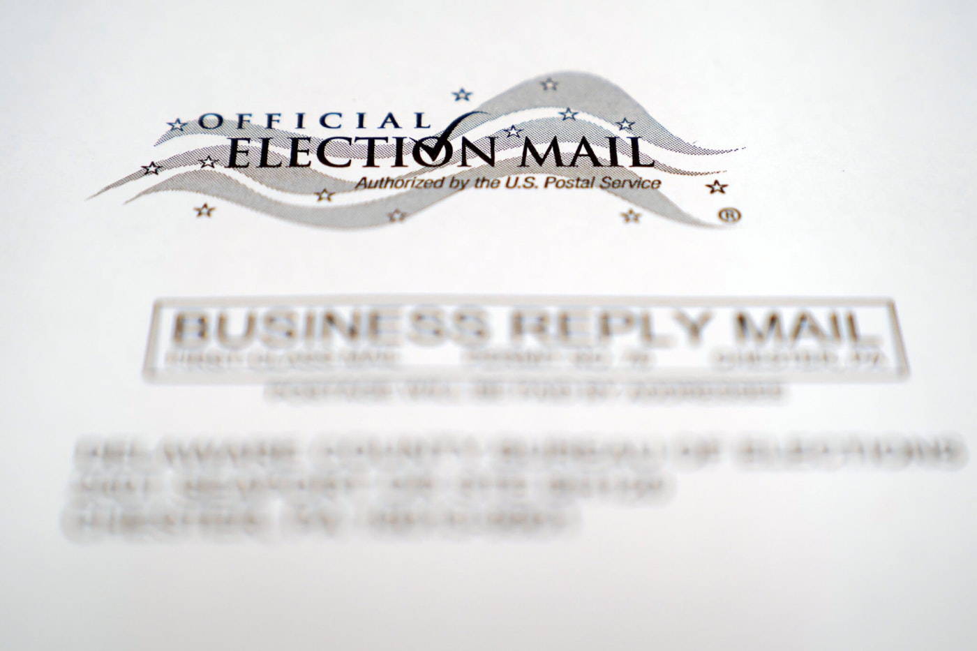 An envelope of a Pennsylvania official mail-in ballot for the 2020 general election is shown, Tuesday, Oct. 13, 2020, in Marple Township, Pa. (AP Photo/Matt Slocum)