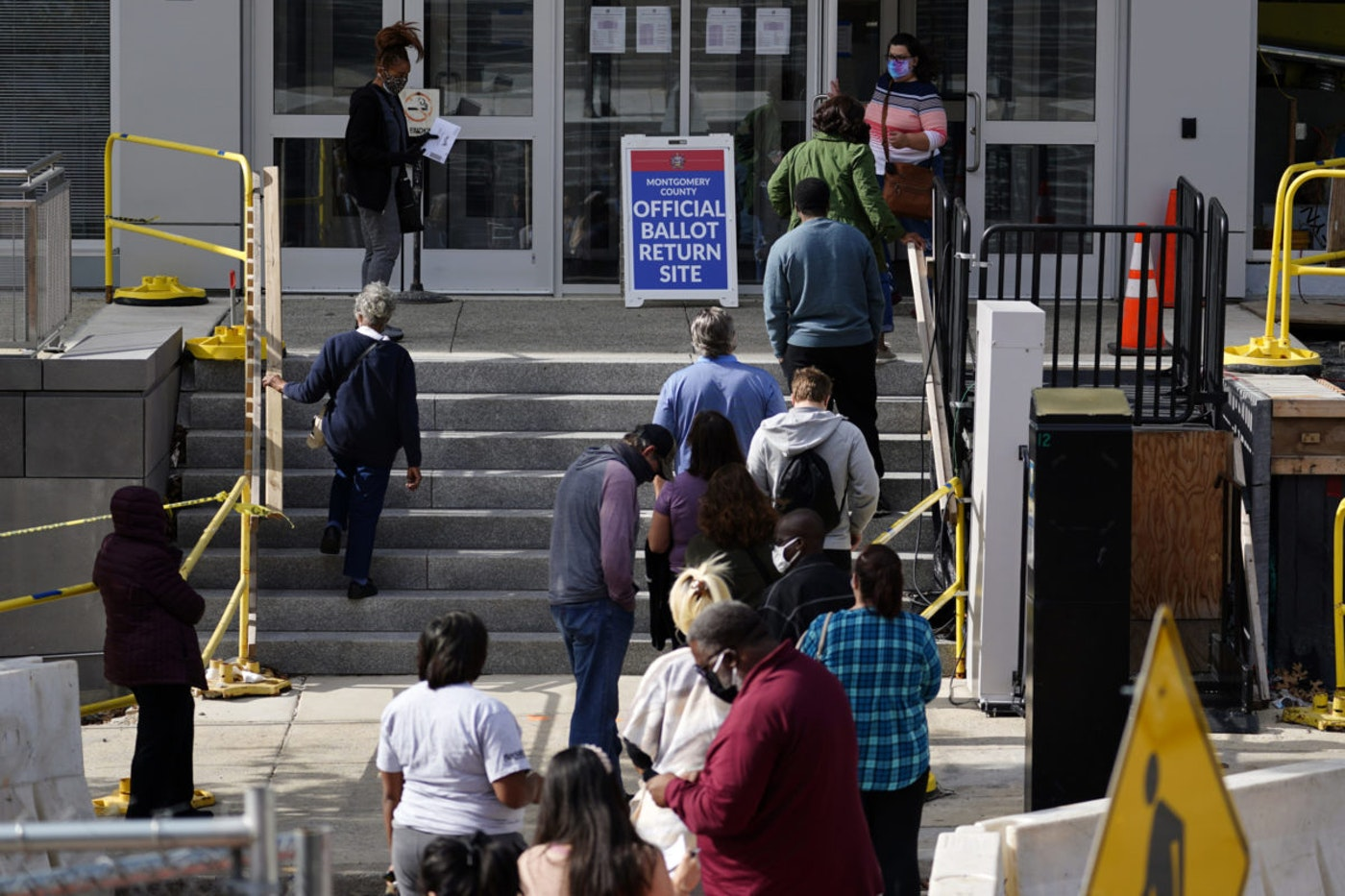 Residents line up outside the Montgomery County, Pa., Voter Services office, Monday, Oct. 19, 2020, in Norristown, Pa. Monday was the last day in Pennsylvania to register to vote in the Nov. 3 election. (AP Photo/Matt Slocum)