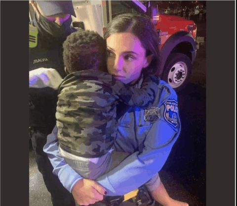 A Philadelphia police officer holds Rickia Young's son after police swarmed the SUV Young was driving, smashed the windows, beat Young and her 16-year-old nephew, and grabbed the toddler from the vehicle just after midnight on Tuesday, Oct. 27, 2020. The National Fraternal Order of Police shared the image on its Facebook page on Wednesday, with a lie about the incident.(Screenshot)
