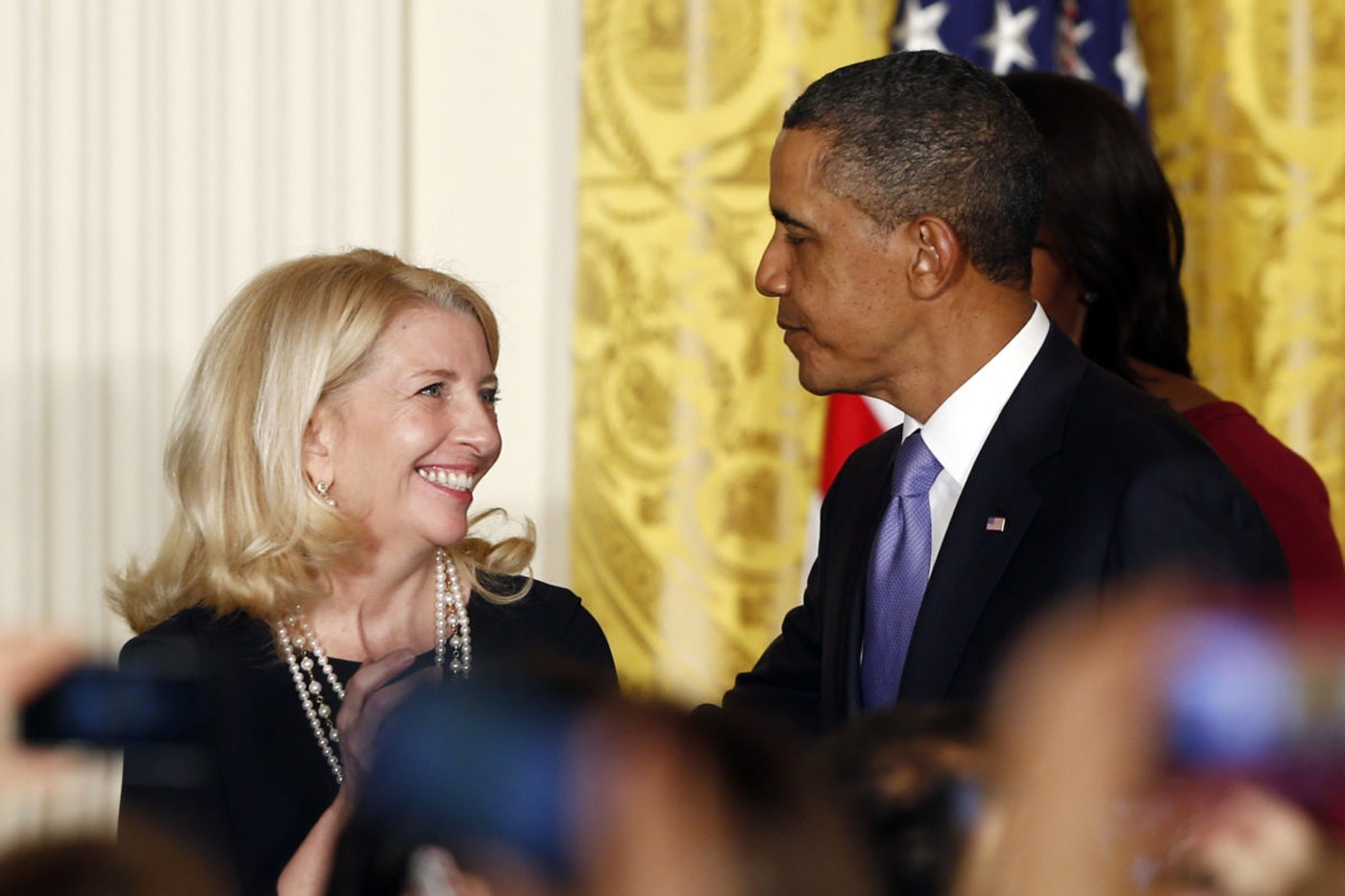 President Barack Obama congratulates Cathy Russell after he nominated her for the position of Ambassador at Large for Global Women's Issues at a Women's History Month reception in the East Room at the White House in Washington, Monday, March 18, 2013. (AP Photo/Charles Dharapak)