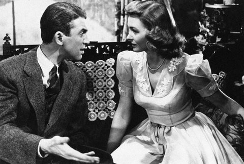 "George Bailey (Jimmy Stewart) explains things to Mary Hatch (Donna Reed) in ""It's a Wonderful Life"" in 1946. (AP Photo)"