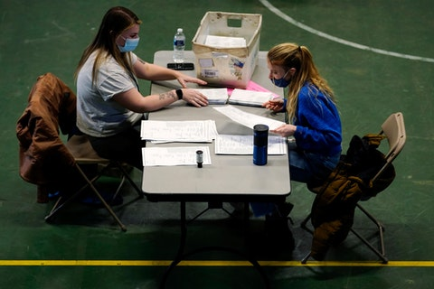 Chester County, Pa., election workers check mail-in and absentee ballots for the 2020 General Election in the United States at West Chester University, Nov. 3, 2020, in West Chester, Pa. (AP Photo/Matt Slocum)