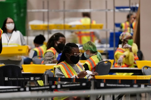 Philadelphia election workers processes mail-in and absentee ballots for the general election at the Pennsylvania Convention Center, on Nov. 3, 2020, in Philadelphia. (AP Photo/Matt Slocum)