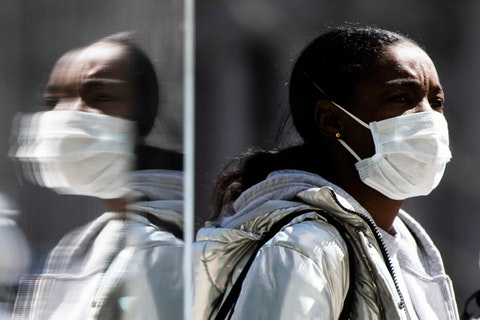 A person wearing protective masks due to coronavirus concerns walks in Philadelphia, Thursday, April 2, 2020. (AP Photo/Matt Rourke)