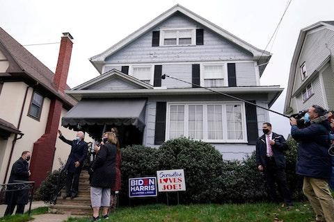 Democratic presidential candidate former Vice President Joe Biden waves while visiting his boyhood home during a stop in Scranton, Pa., Tuesday, Nov. 3, 2020. (AP Photo/Carolyn Kaster)