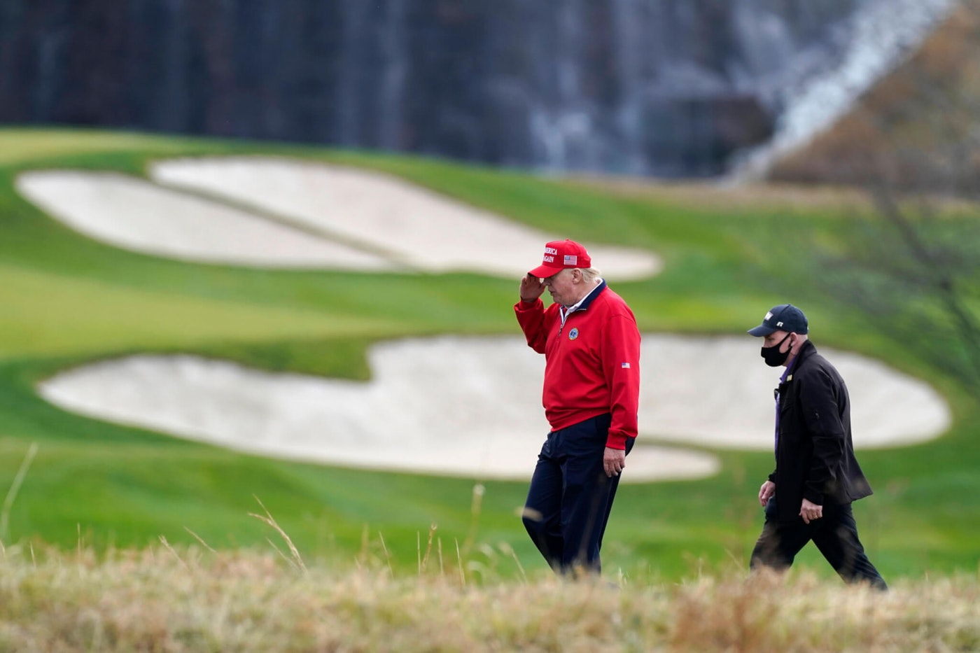 President Donald Trump salutes as he walks to board Marine One after playing golf at Trump National Golf Club, Friday, Nov. 27, 2020, in Sterling, Va. (AP Photo/Alex Brandon)