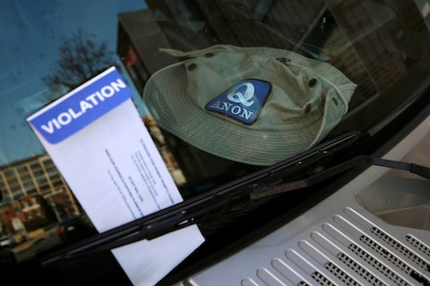 A parking violation envelope is affixed to the windshield of a Hummer parked near the Pennsylvania Convention Center where votes are being counted, Friday, Nov. 6, 2020, in Philadelphia. Police said Friday they arrested two men Thursday for not having permits to carry firearms near the center. Police said the men acknowledged that the Hummer spotted by officers near the center was was their vehicle. (AP Photo/Rebecca Blackwell)