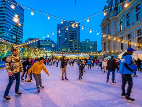 The outdoor Rothman Orthopaedics Ice Rink features ice skating, skate rentals, and twinkling lights in the shadow of Philadelphia City Hall through Feb. 28, 2021. (Courtesy of Visit Philadelphia/J. Fusco)