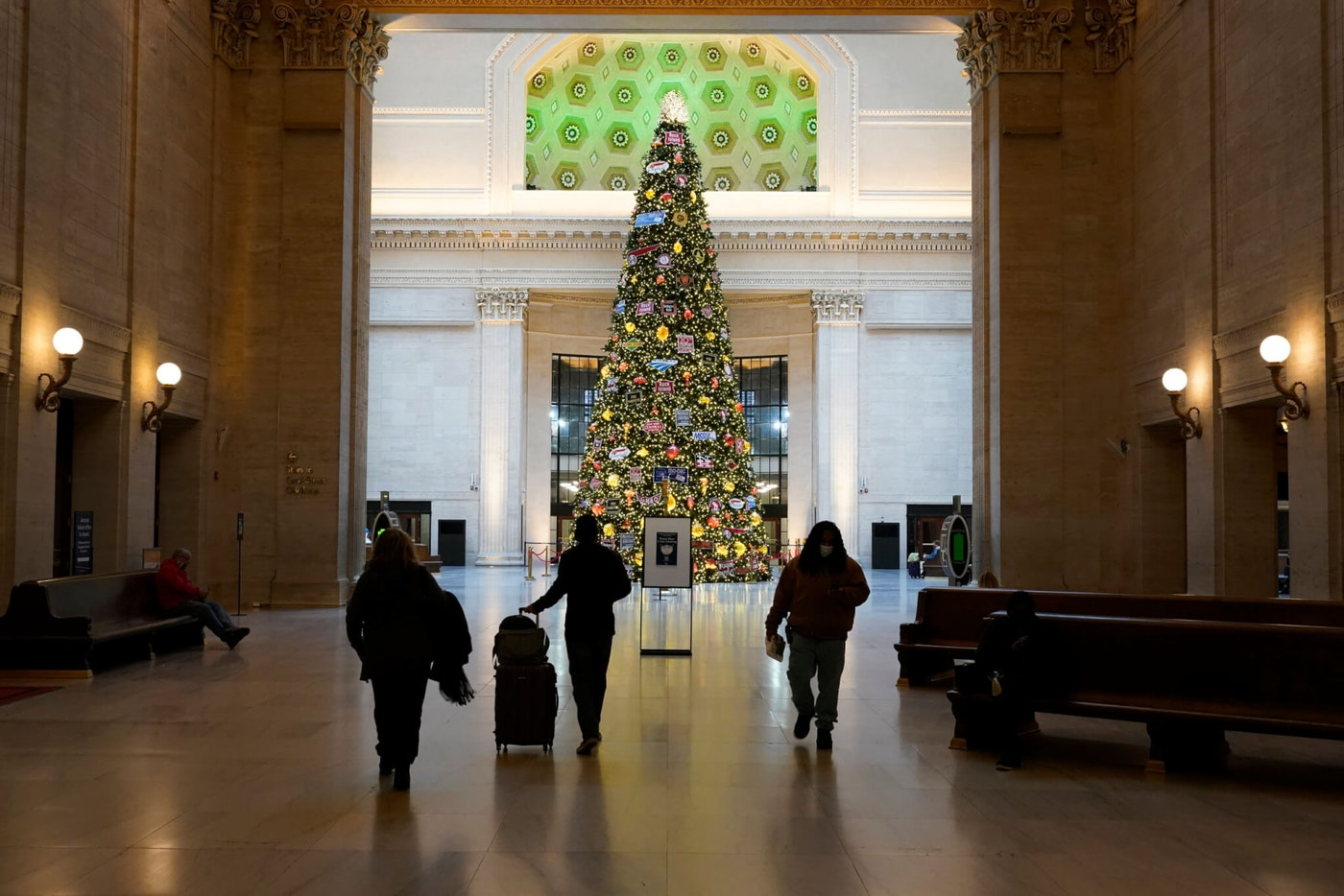 Rail passengers walk to the Grand Hall of Chicago's Union Station on Nov. 25, 2020, the day before Thanksgiving. (AP Photo/Charles Rex Arbogast)
