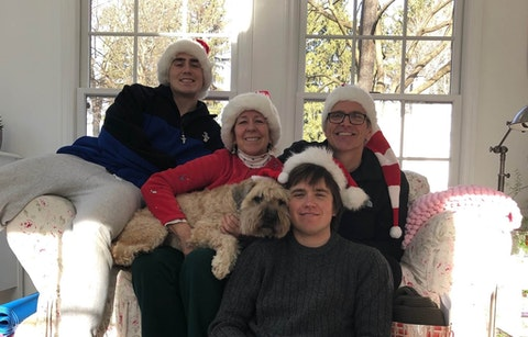 The Moon family, left to right, Gabriel, Joanne, Owen, and Kevin, on Christmas in 2019. Kevin will travel west to spend the holidays with Gabriel and Owen, while Joanne will remain isolated in their Bucks County home. (Courtesy of Joanne Moon)