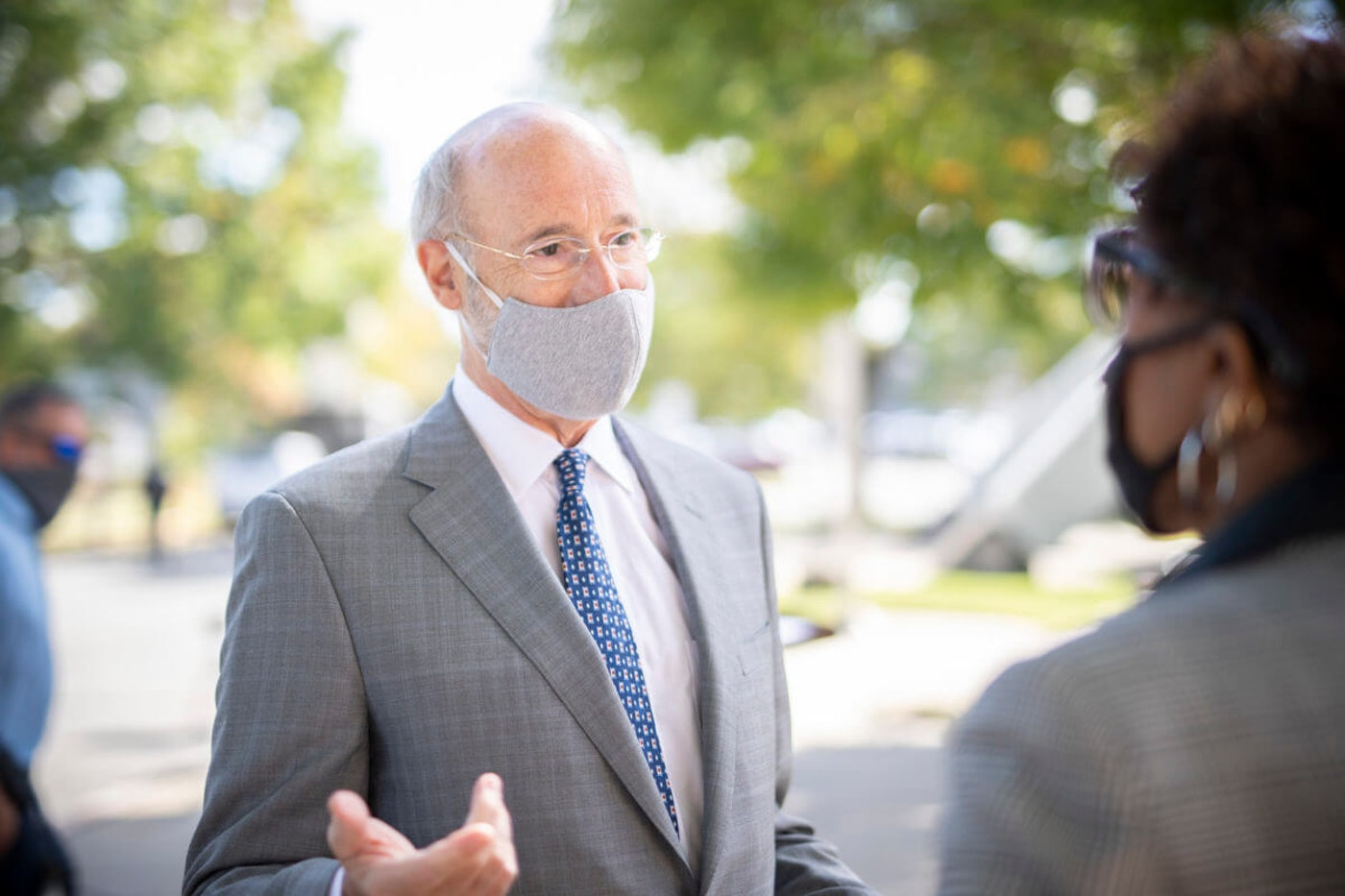 Gov. Tom Wolf speaks to someone at an event in York County in October. (Flickr/Office of Gov. Tom Wolf)