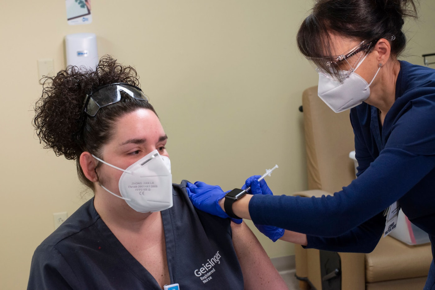 Registered nurse Tara Skutack is one of the first Geisinger front-line staff members to receive a COVID-19 vaccination. Karen Nowicki, LPN, at Geisinger Wyoming Valley Medical Center gave Skutack the first dose of the two-dose vaccine. (Courtesy of Geisinger)