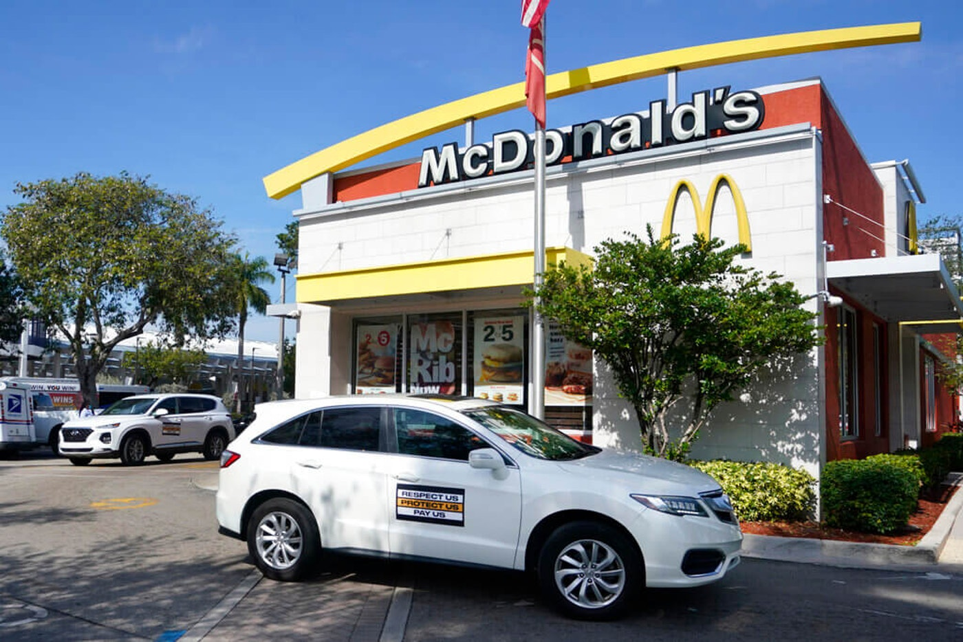 caravans of fast food workers circling McDonald's in demands for an increase in minimum wage