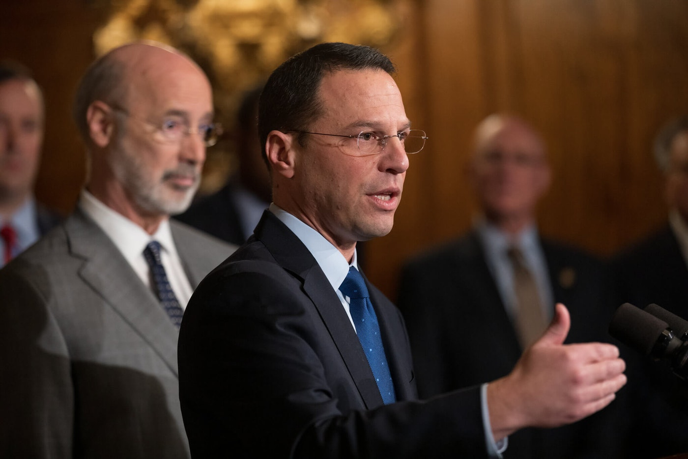 Attorney General Josh Shapiro, speaking in front of Gov. Tom Wolf in 2019, was sworn in for his second term Tuesday.  (Flickr/Office of Gov. Tom Wolf)