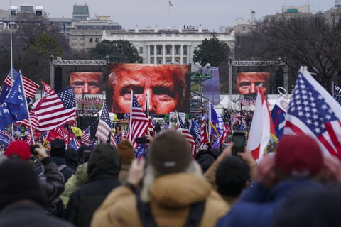 FILE - In this Jan. 6, 2021, file photo, Trump supporters participate in a rally in Washington. Far-right social media users for weeks openly hinted in widely shared posts that chaos would erupt at the U.S. Capitol while Congress convened to certify the election results. Jason Moorehead says he was at the rally, but never went to the Capitol, where the violence occurred. (AP Photo/John Minchillo, File)