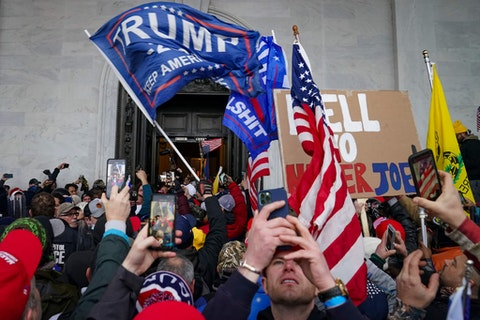 In this Jan. 6, 2021, file photo, Trump supporters gather outside the Capitol in Washington. Several of those who attacked the Capitol have been charged, including Robert Sanford, a former Chester Fire Department firefighter. (AP Photo/John Minchillo, File)