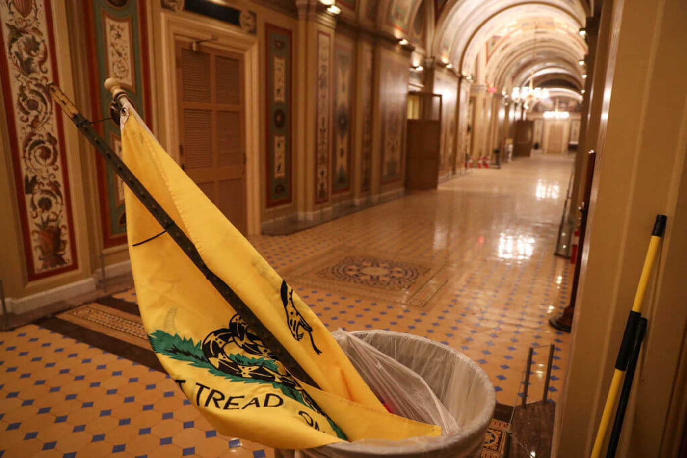 A Gadsden Flag flag left by Pro-Trump terrorists who entered the U.S. Capitol building is seen after mass demonstrations in the nations capital during a joint session Congress to ratify President-elect Joe Biden on January 06, 2021 in Washington, DC. (Photo by Oliver Contreras/For The Washington Post via Getty Images)