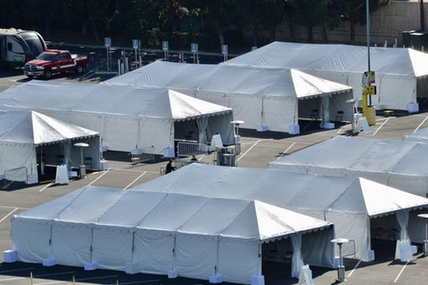 COVID-19 vaccination tents are set up in the north of the Toy Story parking lot at the Disneyland Resort on Jan. 12, 2021, in Anaheim, California. (Orange County Register Photo via Getty Images/Photo by Jeff Gritchen)