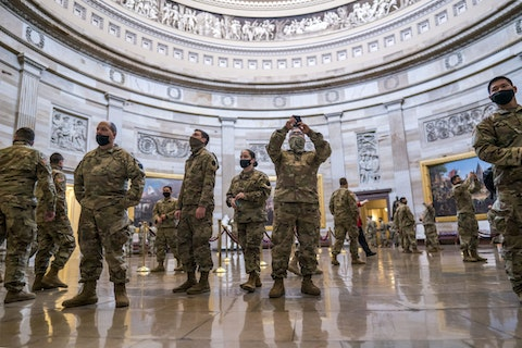 National Guard troops tour the Rotunda at the U.S. Capitol in Washington, during a break from reinforcing security, Monday, Jan. 25, 2021. (AP Photo/J. Scott Applewhite)