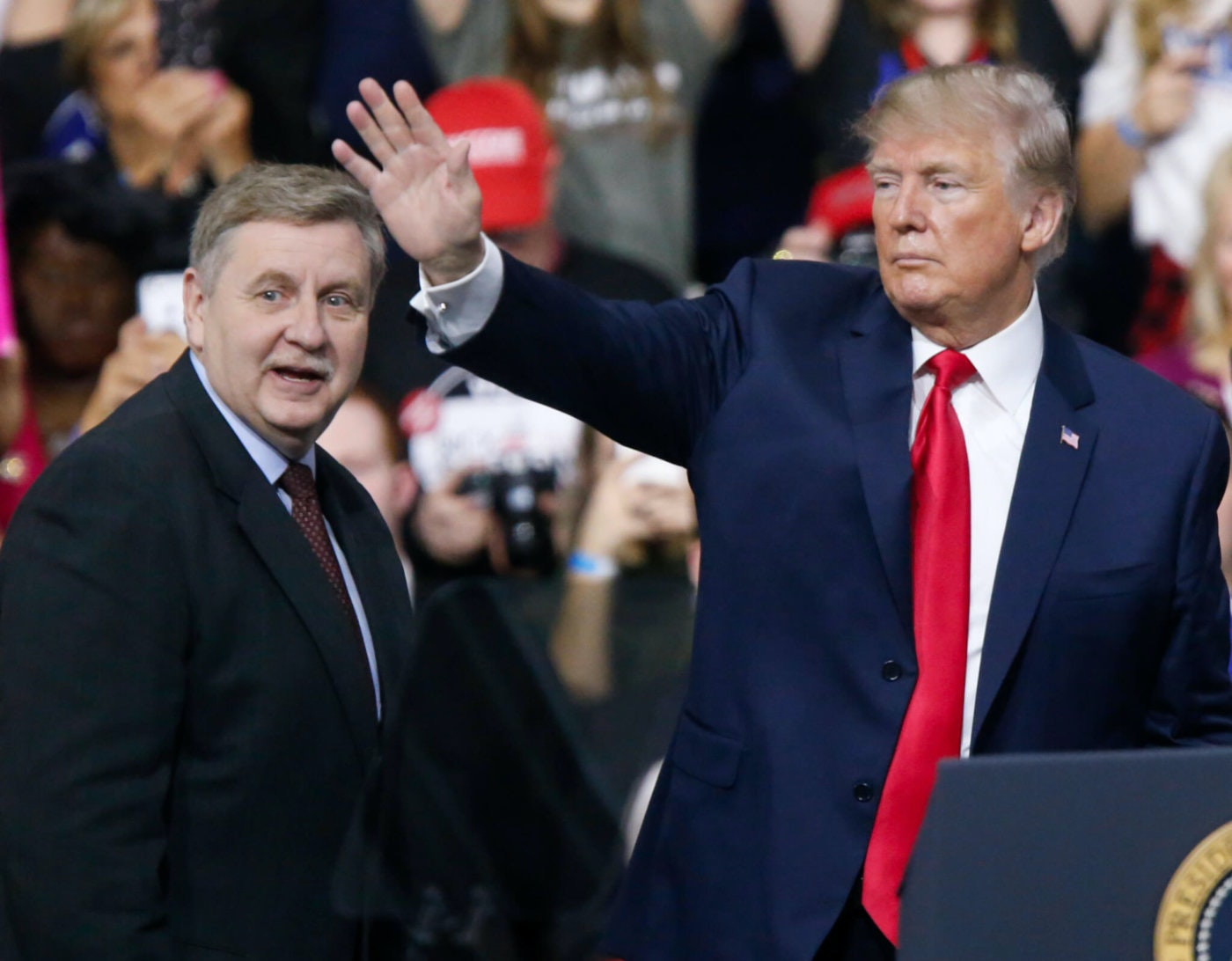Former President Donald Trump acknowledges the crowd during a campaign rally with Republican Rick Saccone, in March 2018 in Allegheny County. (AP Photo/Keith Srakocic)