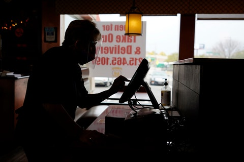 A server enters an order at a Pennsylvania restaurant on Nov. 17, 2020. (AP Photo/Matt Slocum)