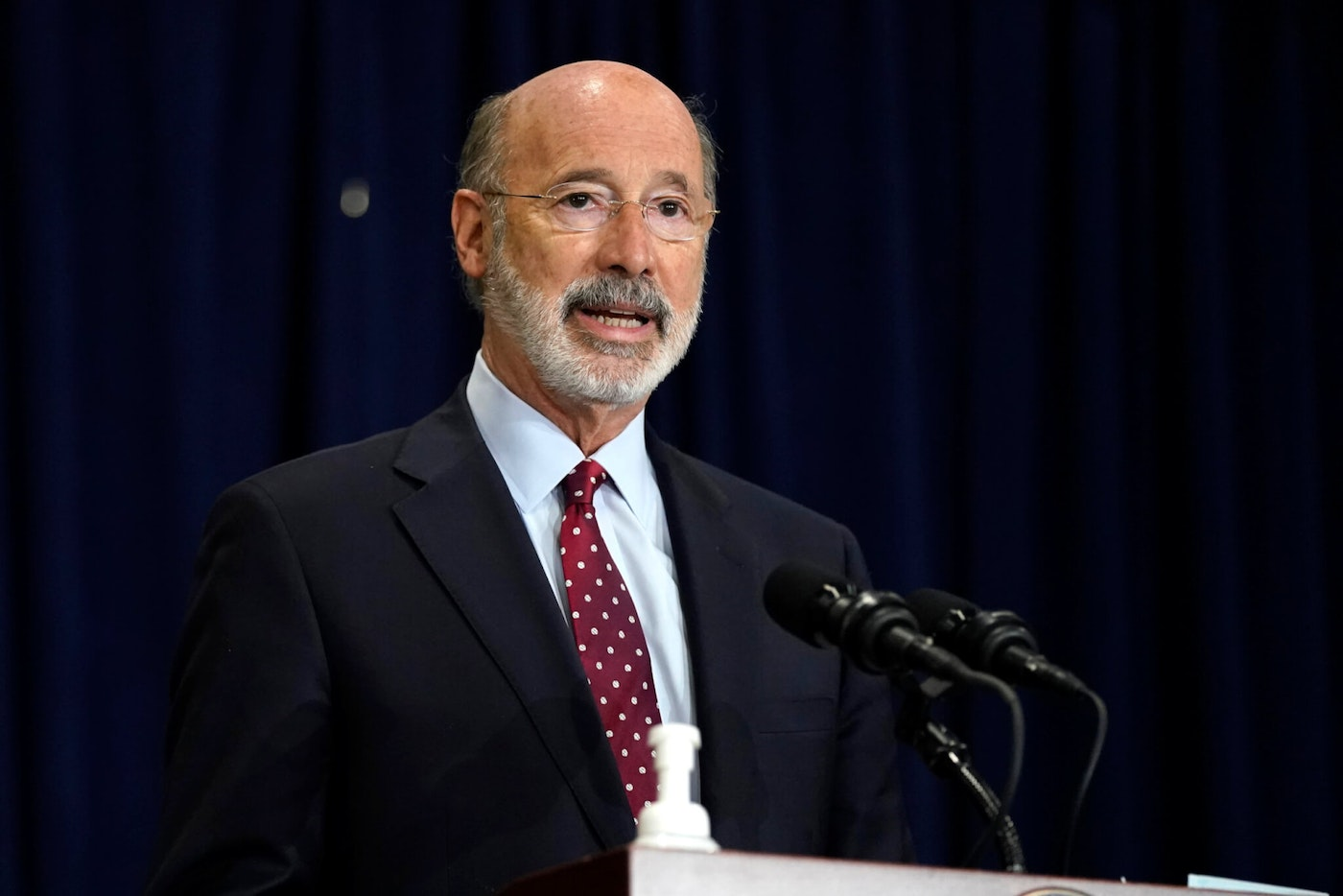 In this Nov. 4, 2020, file photo, Pennsylvania Gov. Tom Wolf speaks during a news conference in Harrisburg, Dauphin County. Facing a deep, pandemic-inflicted budget deficit, Wolf will ask lawmakers for billions of dollars funded by higher taxes on Pennsylvania's huge natural gas industry for workforce development and employment assistance to help the state recover. (AP Photo/Julio Cortez)