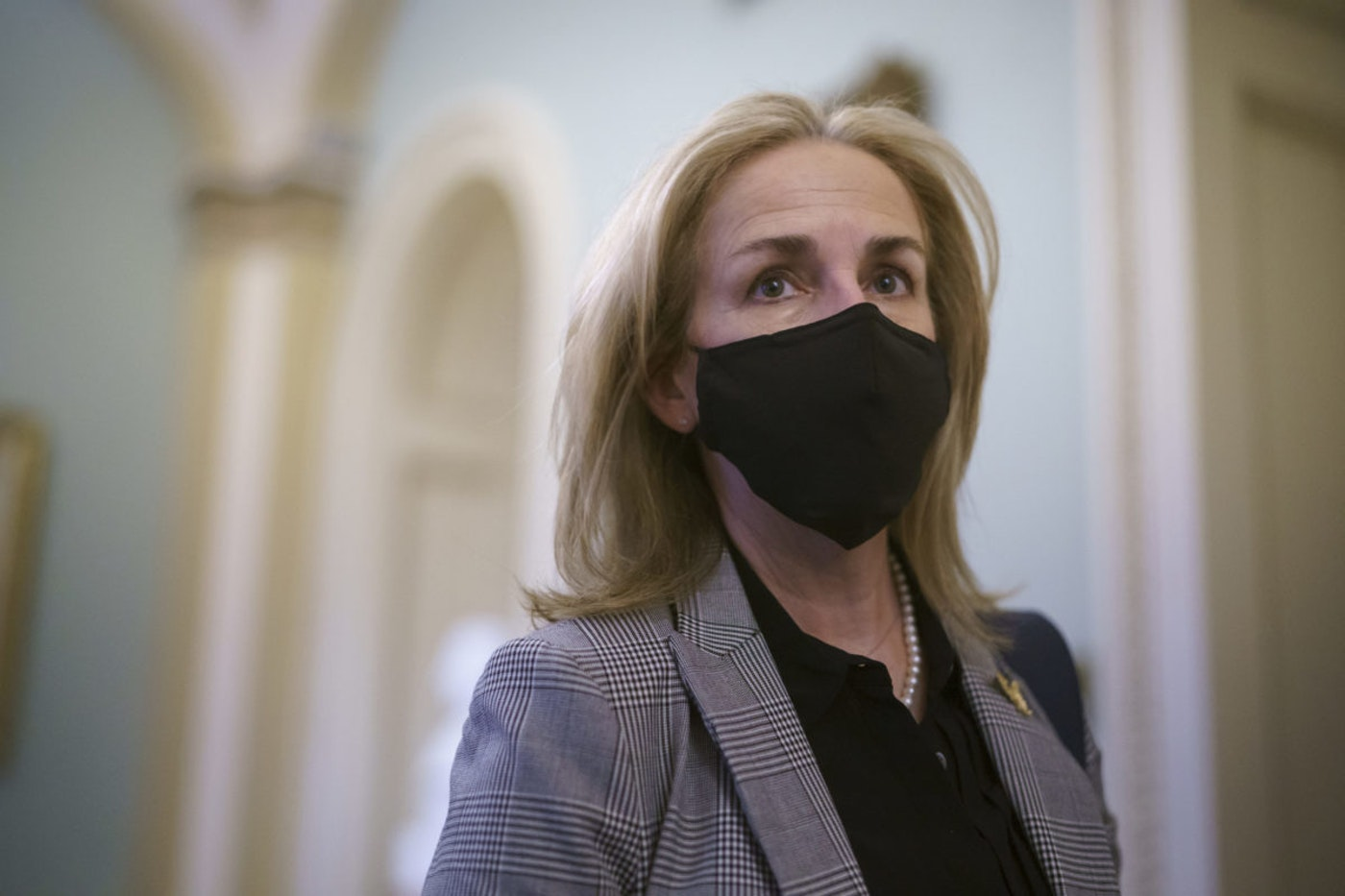 US Rep. Madeleine Dean, D-Pennsylvania, a House impeachment manager in the second impeachment trial of former President Donald Trump, departs at the close of the first day of the proceeding, at the Capitol in Washington, Tuesday, Feb. 9, 2021. (AP Photo/J. Scott Applewhite)