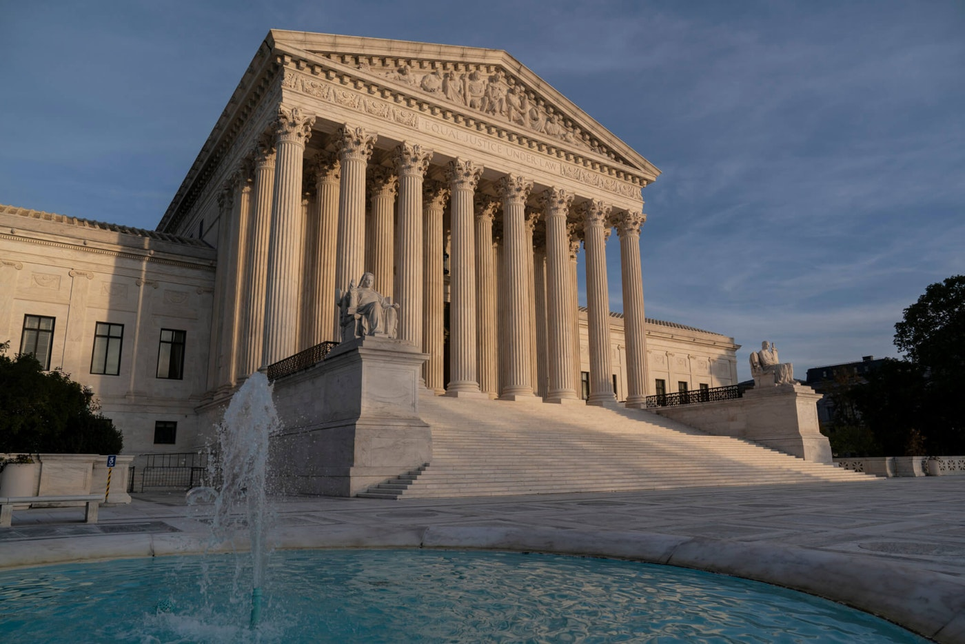 In this Nov. 5, 2020 file photo, the Supreme Court is seen in Washington.  The Supreme Court will take up challenges to controversial Trump administration policies affecting family-planning clinics and immigrants, even though the Biden administration has announced it is reviewing them. (AP Photo/J. Scott Applewhite)