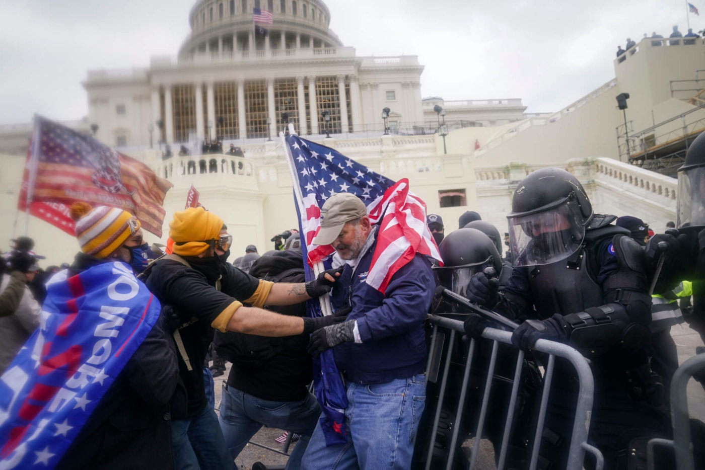 In this Jan. 6, 2021, file photo, domestic terrorists try to break through a police barrier at the Capitol in Washington. (AP Photo/John Minchillo, File)
