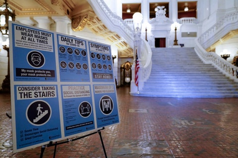 Social distancing and COVID-19 guidelines are posted at the Pennsylvania Capitol in Harrisburg, Pa., Monday, March 22, 2021. The Capitol reopened to the public this month for the first time since December, albeit with social-distancing requirements, no events scheduled inside and a stepped-up police presence following the Jan. 6 attack on the U.S. Capitol. (AP Photo/Matt Rourke)