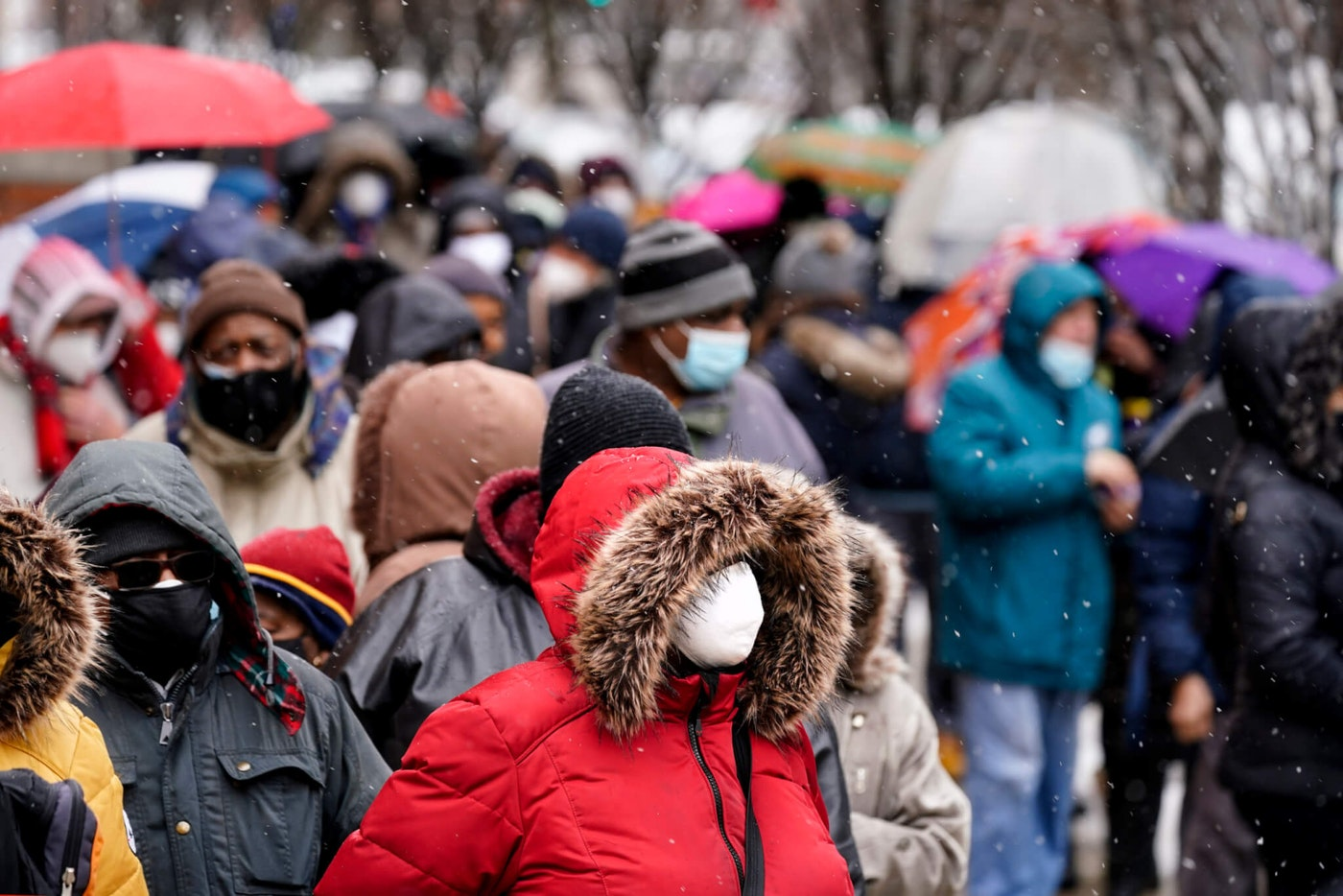 People wait in line at a 24-hour, walk-up COVID-19 vaccination clinic hosted by the Black Doctors COVID-19 Consortium at Temple University's Liacouras Center in Philadelphia, Friday, Feb. 19, 2021. (AP Photo/Matt Rourke)