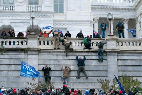 In this Jan. 6, 2021, file photo, supporters of President Donald Trump climb the west wall of the the U.S. Capitol in Washington. (AP Photo/Jose Luis Magana File)