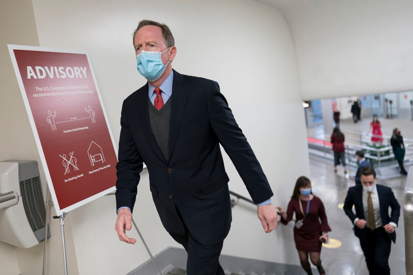 Sen. Pat Toomey, R-Pa., arrives for votes on President Joe Biden's cabinet nominees, at the Capitol in Washington, Thursday, Feb. 25, 2021. (AP Photo/J. Scott Applewhite)