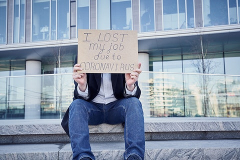 "A man holds a sign that says ""I lost my job because of coronavirus."" Hundreds of thousands of Pennsylvanians have lost their jobs due to the coronavirus pandemic and related business closures. The American Rescue Plan extends unemployment benefits to help them  through September. (Shutterstock Photo/Nata Bene)"