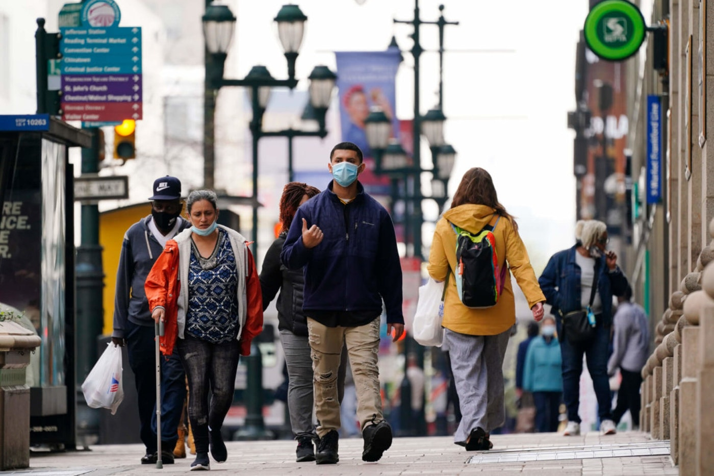 People walk along Market Street in Philadelphia. Pennsylvania got the official word from the US Census that its population growth continues to lag behind the nation's, marking the 10th consecutive decade the Keystone State has lost clout in Congress and presidential contests. (AP Photo/Matt Rourke, File)