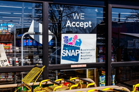 A sign at a store in Muncie, Indiana, announces that the store accepts SNAP benefits. (Shutterstock Photo/Jonathan Weiss)
