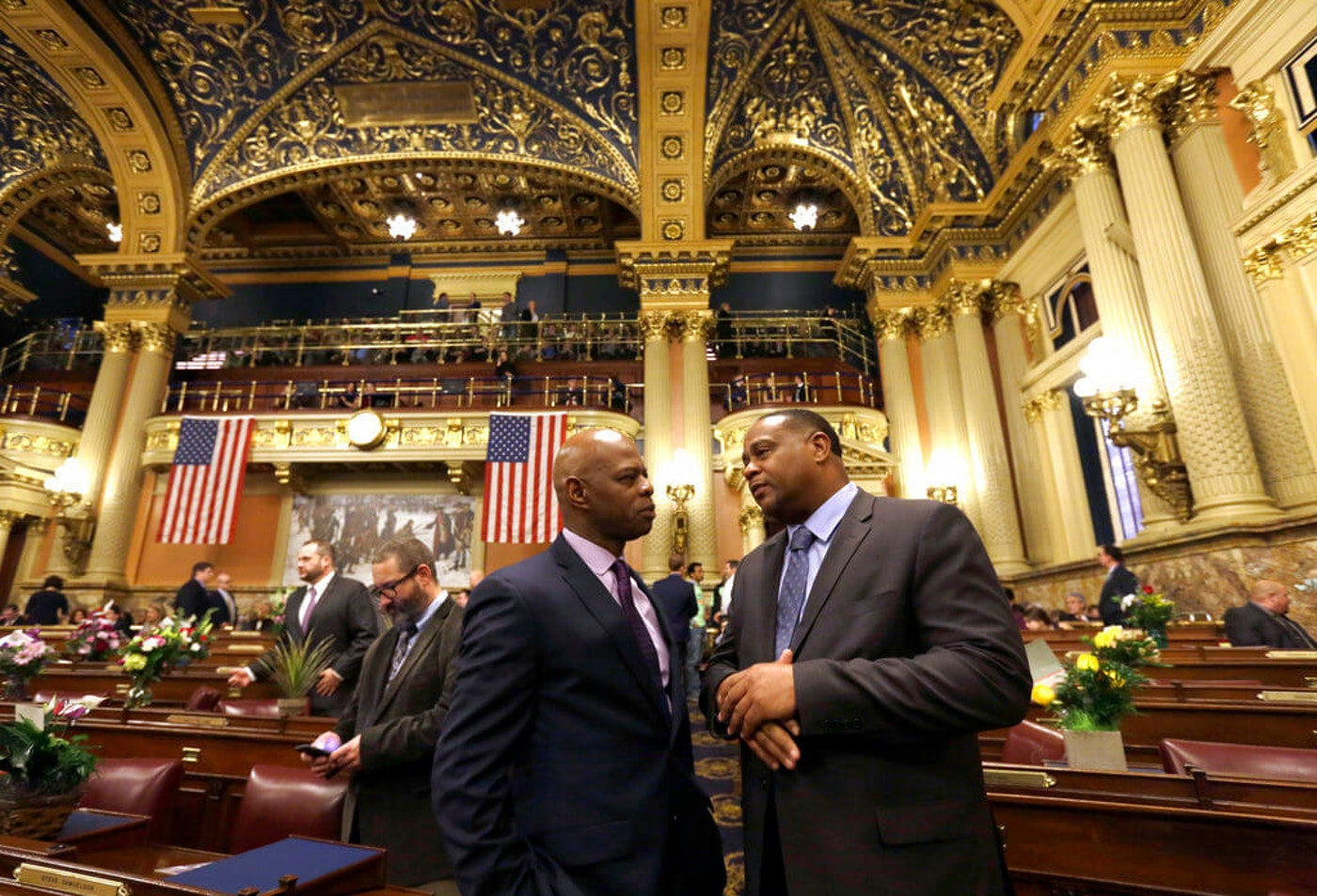 Pennsylvania state House Rep. Ed Gainey, D-Pittsburgh, right, talks with Rep. Stephen Kinsey, D-Philadelphia, Tuesday Jan. 1, 2019, at the statehouse in Harrisburg, Pa. Pennsylvania state lawmakers were sworn in on New Year's Day. The House welcomed 42 new members and seven new senators took the oath of office on Tuesday after winning election in November. (AP Photo/Jacqueline Larma)