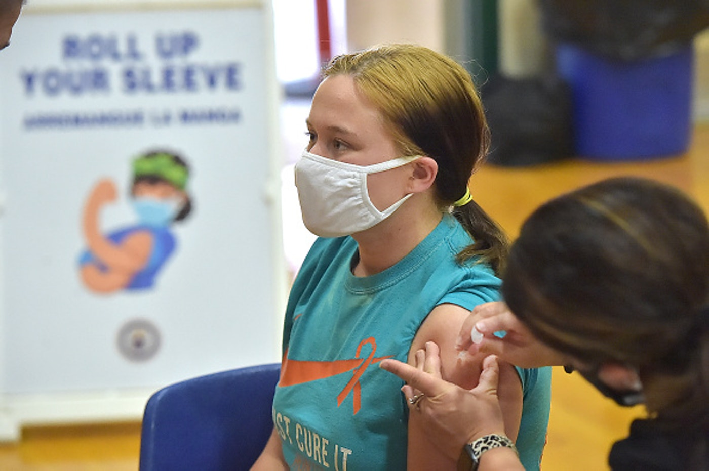 """Junior Molly Day gets her first Pfizer COVID vaccine at Ridley High School in Delaware County, Monday afternoon May, 3, 2021, as part of a clinic for students age 16-18. """"It feels good, I'm happy I can protect myself and others,"""" Day said after she got the shot. (Daily Times Photo via Getty Images/Pete Bannan)"""