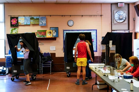 A voter steps from the voting booth after casting a ballot in the Pennsylvania primary in Philadelphia, Tuesday, May 18, 2021. (AP Photo/Matt Rourke)
