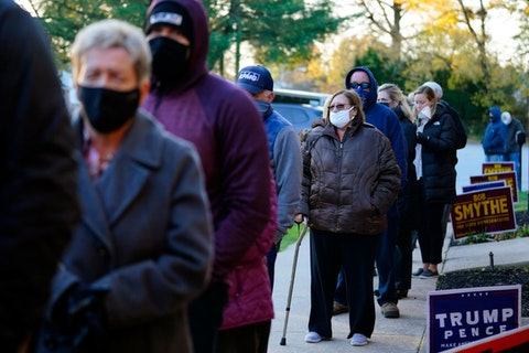 In this Nov. 3, 2020, file photo, people line up outside a polling place in Springfield, Delaware County, to vote in the 2020 general election. A Republican proposal made public on Thursday, June 10, 2021, would revamp Pennsylvania election law to affect deadlines, early voting and mail-in ballots and require ID for all in-person voters. (AP Photo/Matt Slocum, File)