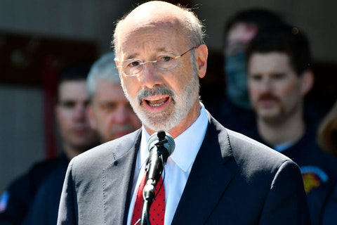 Gov. Tom Wolf speaks at an event in Mechanicsburg, Pa.  Beyond the local races on ballots, Pennsylvania's primary election will determine the future of a governor's authority during disaster declarations. Voters statewide Tuesday, May 18 will decide four separate ballot questions, including two on whether to give state lawmakers much more power over disaster declarations. (AP Photo/Marc Levy)