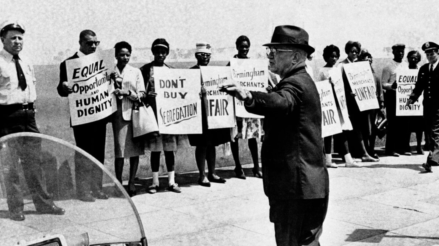 Commissioner Bull Connor directs the arrest of approximately 25 African American demonstrators in Birmingham, Ala. on April 10, 1963. Singer Al Hibbler who led the protest march, heads the line left background. Connor who directs the police department said Hibbler would not be taken into custody. (AP Photo/Horace Cort)