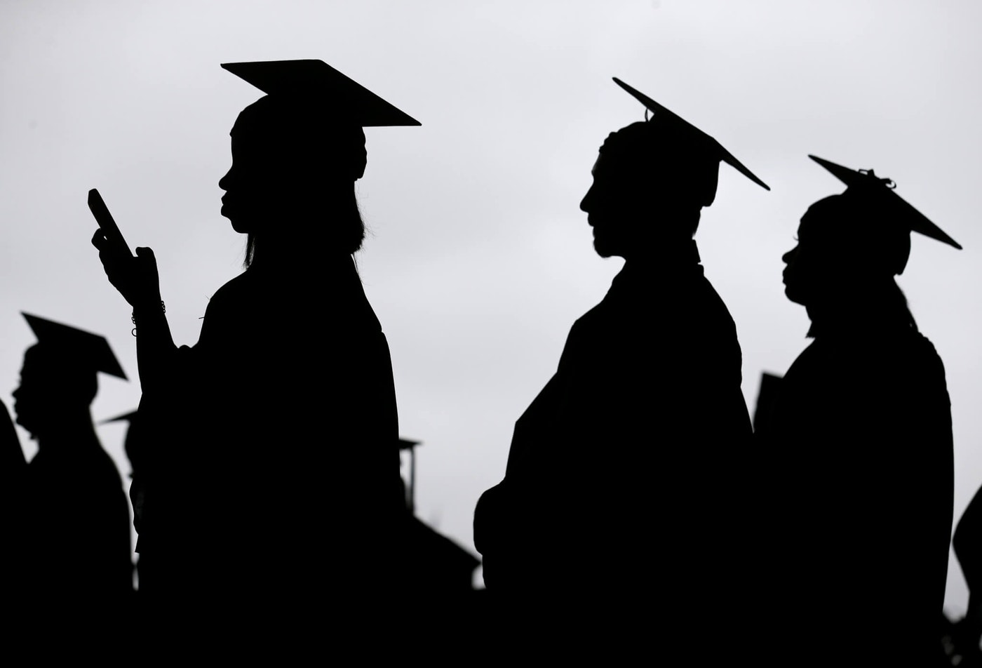 New graduates line up before the start of commencement ceremonies. (AP Photo/Seth Wenig, File)