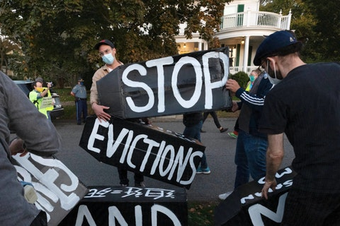 In this Oct. 14, 2020, file photo, housing activists erect a sign in Swampscott, Mass. A federal freeze on most evictions is set to expire soon. The moratorium, put in place by the Centers for Disease Control and Prevention in September, was the only tool keeping millions of tenants in their homes. (AP Photo/Michael Dwyer, File)