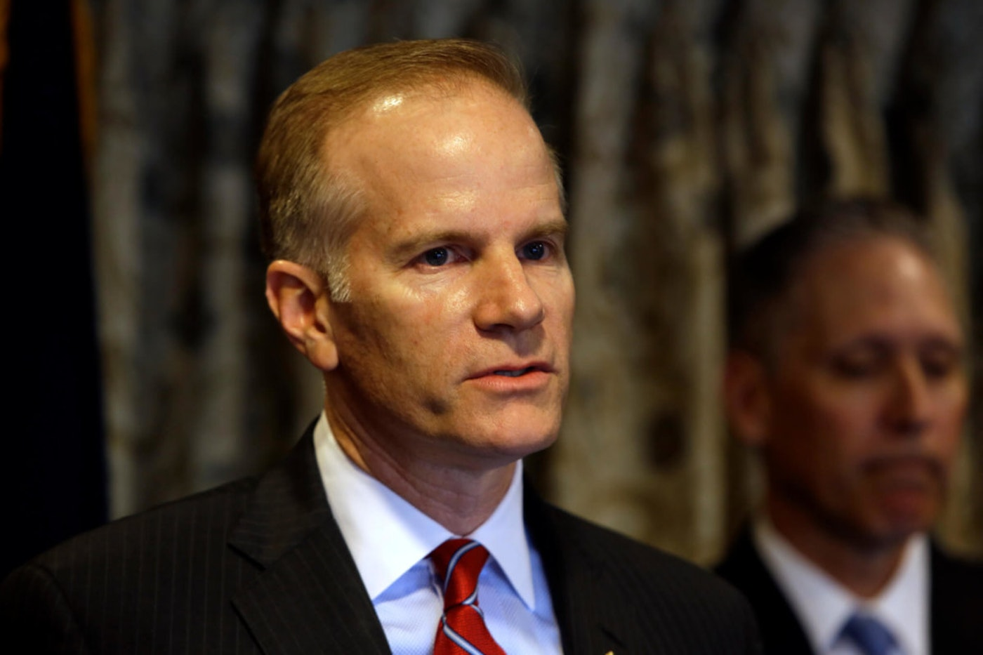 US Attorney William McSwain pauses during a news conference at the Lancaster County Courthouse in July 2019. McSwain, the top federal prosecutor in Philadelphia appointed by Donald Trump, has written to the former president to seek his endorsement in a crowded Republican primary race to run for governor in next year's election. (AP Photo/Jacqueline Larma, File)